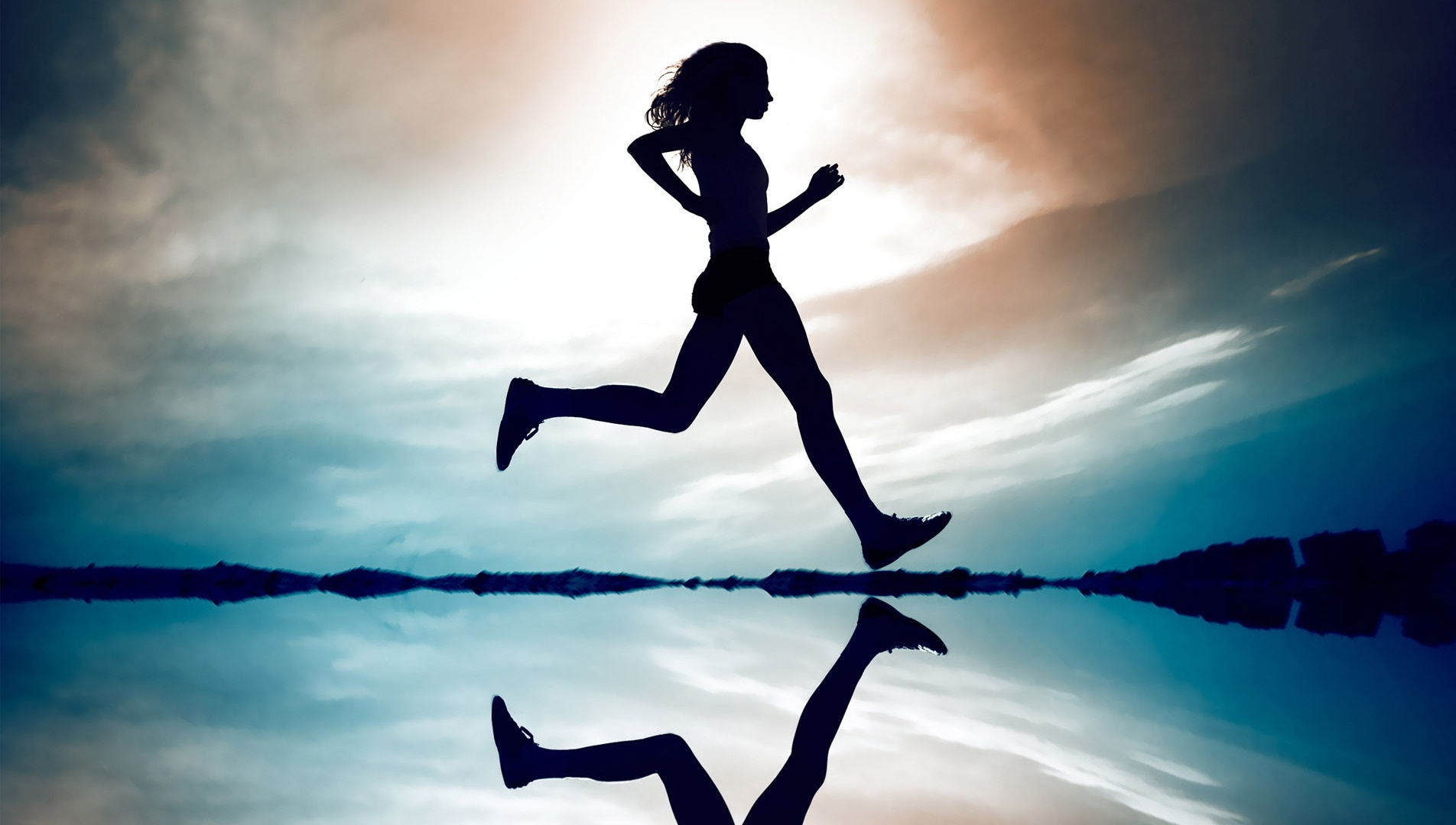 young_woman_silhouette_running_on_the_beach-other